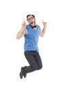Lycklig nerd som hoppar upp och pekar arkivfoton