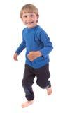 lycklig over running white för pojke Arkivfoton