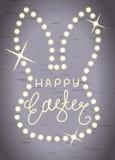 Lycklig påsk, linje bokstäver i den head ramen för glänsande kanin Royaltyfri Fotografi
