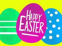 Lycklig påskhälsning med kulöra målade ägg för vatten arkivbild