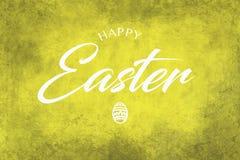 Lycklig påskhälsning på en gul bakgrund royaltyfria bilder