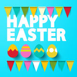 Lycklig påsktitel med ägg på blå bakgrund Royaltyfri Bild
