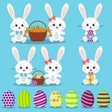 Lycklig påskuppsättning: isolerade roliga kaniner med färgrika ägg stock illustrationer