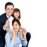 lycklig pardotter deras barn Royaltyfri Foto