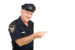 lycklig pekande polis Arkivbilder