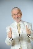 lycklig pensionär för affärsman Arkivbilder