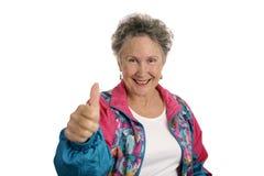 lycklig pensionärthumbsup Arkivfoto