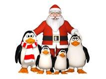 Lycklig pinguinsfamilj med jultomten Arkivfoton