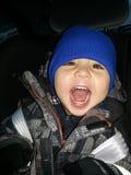 Lycklig pojke i bilen Royaltyfria Foton