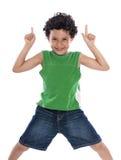 Lycklig pojke med fingrar som pekar upp Arkivfoto