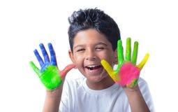Lycklig pojke med målarfärg som har gyckel Royaltyfria Foton