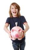 Lycklig pojke med piggybank Royaltyfri Fotografi