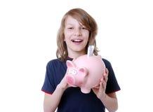 Lycklig pojke med piggybank Arkivfoton