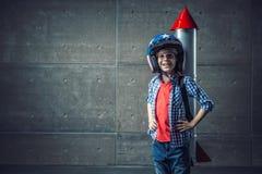 Lycklig pojke med raket Arkivbild