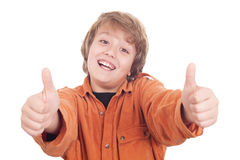 Lycklig pojke med tum upp Fotografering för Bildbyråer
