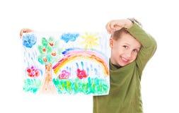 Lycklig pojke som visar hans målning arkivfoton