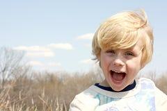 Lycklig pojke utanför Royaltyfria Bilder