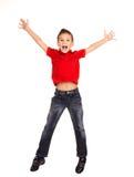 Lycklig pojkebanhoppning med lyftta händer upp Royaltyfria Foton