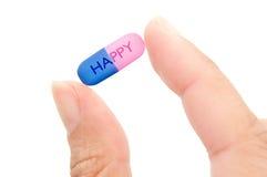 Lycklig preventivpiller Arkivfoto