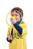 Lycklig pys med en tennisracket och boll Royaltyfri Foto