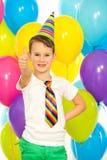 Lycklig pys med färgrika ballonger på royaltyfria foton