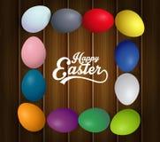 Lycklig ram för påskägg med text Färgrika påskägg på brun träbakgrund royaltyfria foton