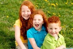 lycklig redhead för barn Fotografering för Bildbyråer