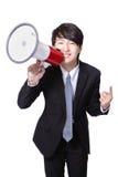 Lycklig ropa megafon för affärsman Arkivbild