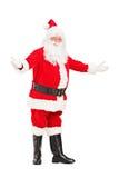 Lycklig Santa Claus göra en gest välkomnande Arkivbilder
