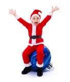 Lycklig Santa Claus pojke på prydnaden Royaltyfri Foto
