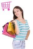 Lycklig shoppingkvinna med ett vagnstecken royaltyfri fotografi