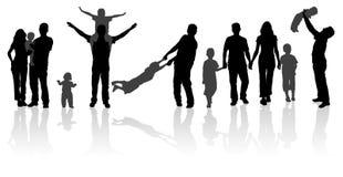 lycklig silhouette för familj Arkivfoto