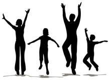 lycklig silhouette för familj Arkivbilder