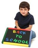 lycklig skola för tillbaka pojke till royaltyfria bilder