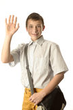 Lycklig skolapojke arkivbild