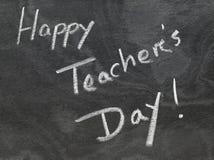 Lycklig skriftlig läraredag i svart tavla Royaltyfri Fotografi