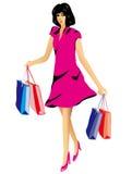 Lycklig smilling kvinna med shoppingpåsar Arkivbilder