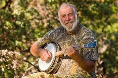 lycklig spelare för banjo Arkivfoto
