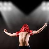 lycklig spelarefotboll Royaltyfri Fotografi