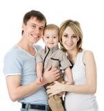 lycklig stående för familj bakgrund isolerad white Royaltyfria Foton