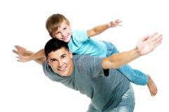 lycklig ståendeson för fader Arkivbilder