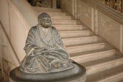 lycklig staty för buddah Arkivfoto
