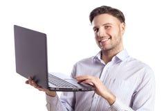 Lycklig stilig affärsman Holding en bärbar dator Royaltyfria Bilder
