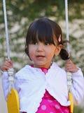 lycklig swing för barn Arkivbild