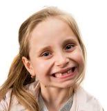Lycklig tandlös flicka Fotografering för Bildbyråer