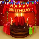 Lycklig 10th födelsedag med chokladpralinkakan och den triangulära flaggan Arkivbilder