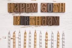 Lycklig 60th födelsedag som stavas i typuppsättning Royaltyfri Fotografi
