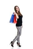 Lycklig tonårig flicka med shoppingpåsar Royaltyfri Fotografi