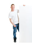 Lycklig tonåring som rymmer ett tomt baner Royaltyfria Foton