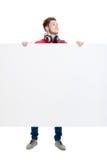 Lycklig tonåring som rymmer ett tomt baner Royaltyfri Foto